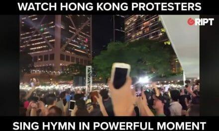 Hong Kong protestors sing hymn in powerful moment