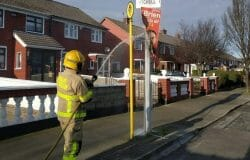 Election Mystery: Who called the fire brigade to the scene of a single burning poster?