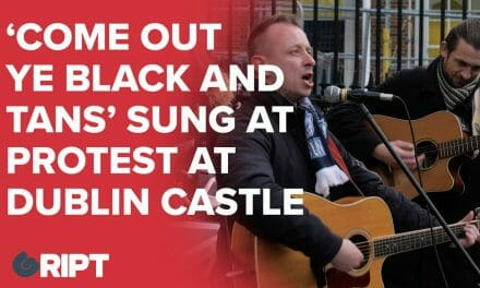 "Buskers sing ""Come out ye black and tans"" outside Dublin Castle in protest of deferred Fine Gael RIC event."