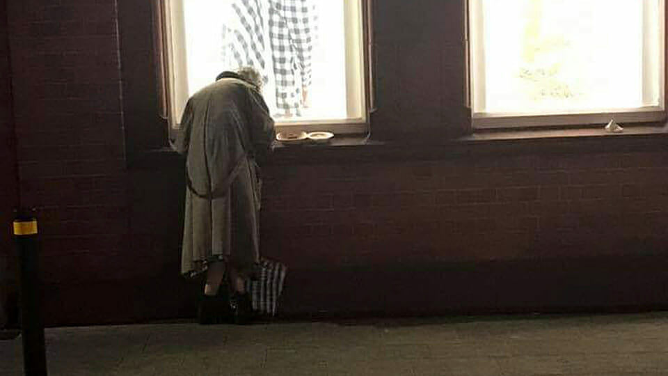 """A death of hope"": Shock as photo of homeless elderly lady eating dinner on window sill reveals extent of crisis in Ireland"